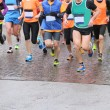 Runners during marathon and it is raining — Stock Photo #68249725
