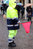 Policeman with the red flag to signal the roadblock — Stock Photo