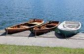 Three rowboats moored on the shore of Lake — Stock Photo