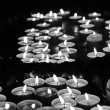 Many lit candles at mass in church — Stock Photo #71173503