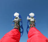 Mountaineer's legs with snowshoes for excursions on the snow — Stock Photo
