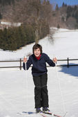 Kid try cross-country skiing on the white snow in the mountains — Stock Photo