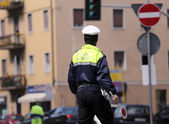 Italian policeman in uniform while blocking traffic with the Red — Stock Photo