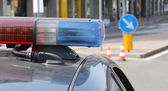 Blue and red flashing sirens of police car in the city — Stock Photo