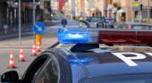 Blue sirens of police car during the roadblock in the city — Stock Photo