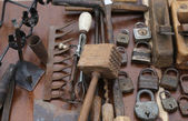 Hammer and rusty padlocks and planers in the workshop of flea ma — Stock Photo