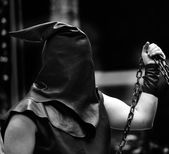 Executioner with black hood on his head and the chain — Stock Photo