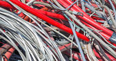 Red  electrical wires in the dump of special material — Stock Photo