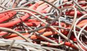 Electrical wires and other lengths of copper wire in the dump of — Stock Photo