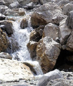 Water in mountain Brook during the meltdown of the glacier — Stock Photo