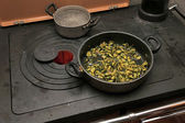 Green Zucchini with pot over the stove in the mountains — Stock Photo