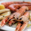 Two huge prawns grilled in the dish of the restaurant — Stock Photo #73187075