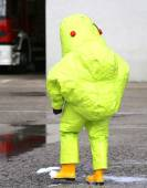 Firefighter with yellow protective gear against biological risk — Stock Photo