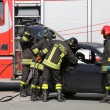 Постер, плакат: Firefighters in action during the road accident