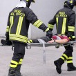 Постер, плакат: Firefighters carried the injured away on stretchers