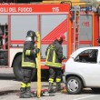 Постер, плакат: Firefighters at the scene of the accident to rescue