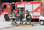 Road accident with car parts and the firetruck  — Stock Photo
