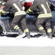 Постер, плакат: Firefighters in action during a traffic accident