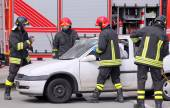 Firemen in action after the traffic accident — Zdjęcie stockowe