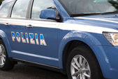 Italian blue police car in the road with written POLICE — Stock Photo