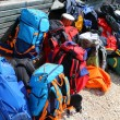 Backpacks of hikers before departure in the high mountains — Stock Photo #74774353