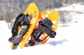 Two orange snowshoes in mountains in winter — Stock Photo