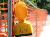 Road yard with signal lamp on road excavation — Stock Photo