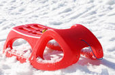 Sled for playing in the snow in mountains — Stock Photo