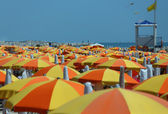 Colorful parasol on the beach — Stock Photo