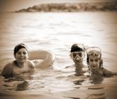 Three young brothers have fun playing in the sea — Stock Photo