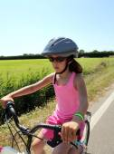 Eight year old girl goes to bike with helmet — Stock Photo
