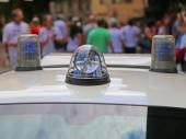 Police car with lights and siren in the city — Stock Photo