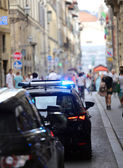 Italian police car with lights and siren in the city — Stock Photo