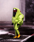 Man with yellow protective gear against biological risk — Stock Photo