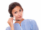 Charismatic operator woman speaking on microphone — Stock Photo