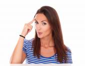 Lovely female pointing to her forehead — Stock Photo