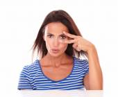 Charming female making a victory sign — Stock Photo