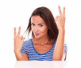 Charming hispanic lady with fingers up — Foto de Stock