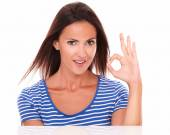 Smiling young lady gesturing ok sign — Foto de Stock
