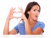 Lady in blue t-shirt with heart sign — Stock Photo