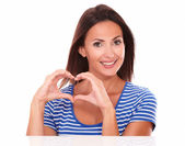 Smiling young lady with heart sign — Foto de Stock