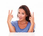 Attractive young woman with victory sign — Foto de Stock