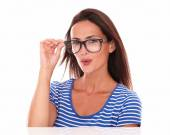 Fashionable female smiling and wearing spectacles — Stock Photo