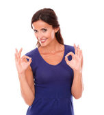 Cheerful latin woman gesturing a great job — Stock Photo