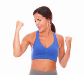 Sporty pretty woman happily celebrating victory — Stock Photo