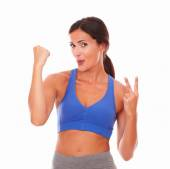 Sporty young woman feeling victoriously excited — Stock Photo