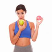 Fit young woman holding tempting food — Stock Photo