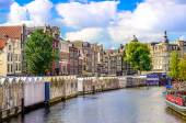Scenic view of canal in Amsterdam at flower market — Stock Photo