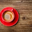 View of coffee in red cup on wooden vintage table — Stock Photo #64456039