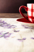 Detail of coffee cup laid on wooden vintage table — Stock Photo